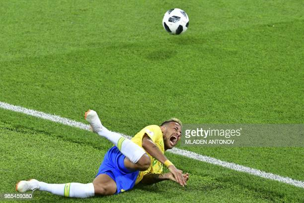 TOPSHOT Brazil's forward Neymar reacts after a foul during the Russia 2018 World Cup Group E football match between Serbia and Brazil at the Spartak...