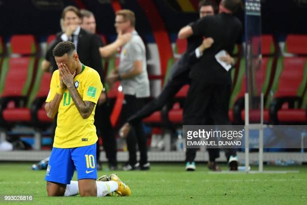 TOPSHOT Brazil's forward Neymar reacts at the end of the Russia 2018 World Cup quarterfinal football match between Brazil and Belgium at the Kazan...