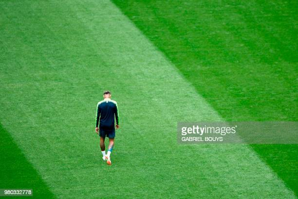 TOPSHOT Brazil's forward Neymar reacts during a training session at the Saint Petersburg Stadium in Saint Petersburg on June 21 2018 on the eve of...