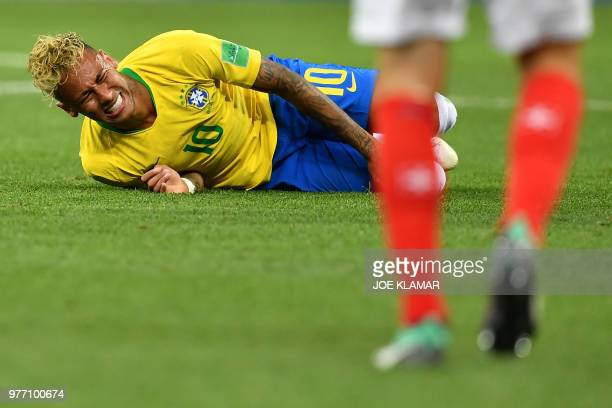 Brazil's forward Neymar reacts during the Russia 2018 World Cup Group E football match between Brazil and Switzerland at the Rostov Arena in...