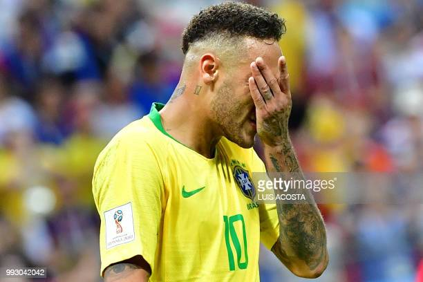 TOPSHOT Brazil's forward Neymar reacts during the Russia 2018 World Cup quarterfinal football match between Brazil and Belgium at the Kazan Arena in...