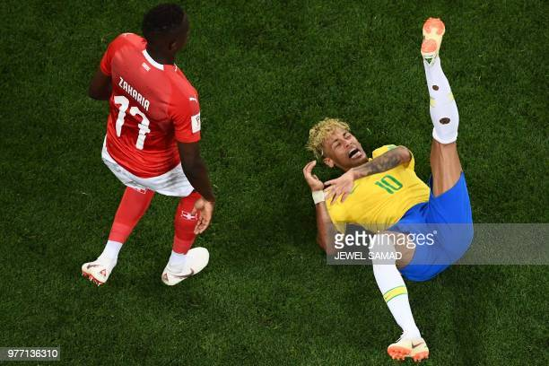 TOPSHOT Brazil's forward Neymar reacts next to Switzerland's midfielder Denis Zakaria during the Russia 2018 World Cup Group E football match between...