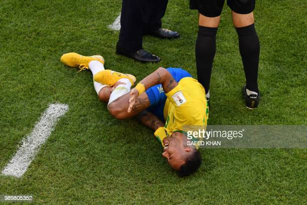 Brazil's forward Neymar reacts on the sidelines during the Russia 2018 World Cup round of 16 football match between Brazil and Mexico at the Samara...