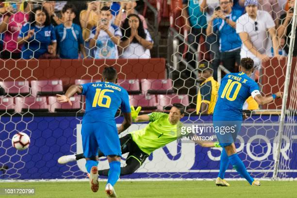TOPSHOT Brazil's forward Neymar score with a free kick against El Salvador during an international friendly at FedEx Field in Landover MD on...