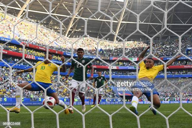 Brazil's forward Neymar scores a goal during the Russia 2018 World Cup round of 16 football match between Brazil and Mexico at the Samara Arena in...