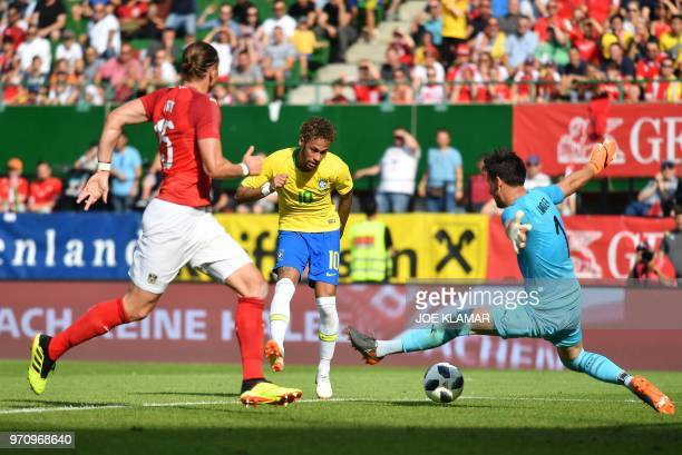 Brazil's forward Neymar scores past Austria's goalkeeper Heinz Lindner during the international friendly footbal match Austria vs Brazil in Vienna on...