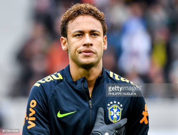 Brazil's forward Neymar sings the national anthem ahead of a friendly football match between Japan and Brazil at The Pierre Mauroy Stadium in...