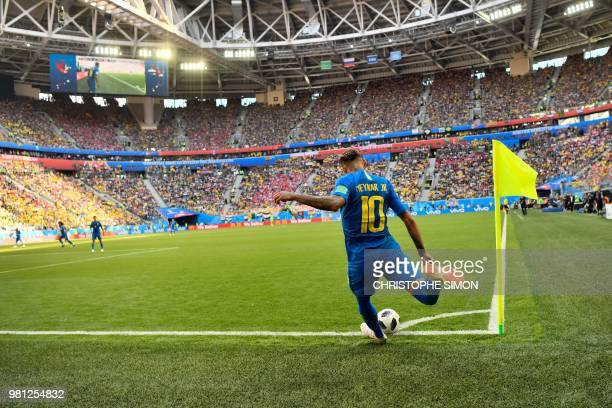 TOPSHOT Brazil's forward Neymar takes a corner during the Russia 2018 World Cup Group E football match between Brazil and Costa Rica at the Saint...