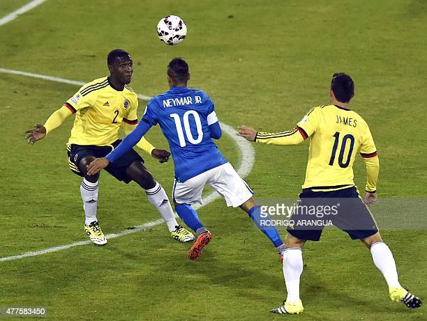 Brazil's forward Neymar vies for the ball with Colombia's defender Cristian Zapata and Colombia's midfielder James Rodriguez during their Copa...
