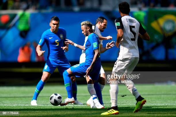 Brazil's forward Neymar vies with Costa Rica's forward Marco Urena during the Russia 2018 World Cup Group E football match between Brazil and Costa...