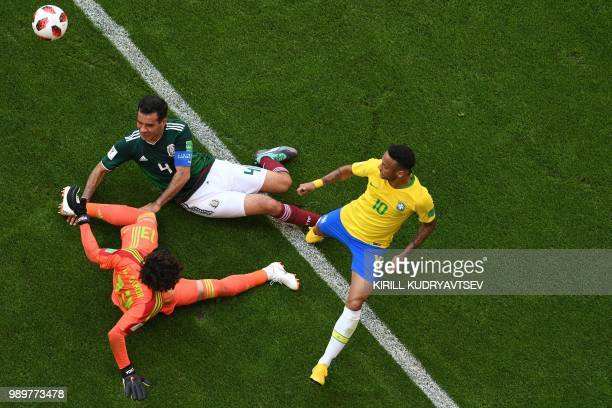 Brazil's forward Neymar vies with Mexico's goalkeeper Guillermo Ochoa and Mexico's midfielder Rafael Marquez during the Russia 2018 World Cup round...