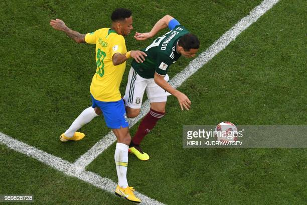 Brazil's forward Neymar vies with Mexico's midfielder Andres Guardado during the Russia 2018 World Cup round of 16 football match between Brazil and...