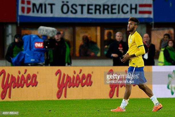 Brazil's forward Neymar warks during a friendly football match Austria vs Brazil at the Ernst Happel Stadium in Vienna on November 18 2014 AFP PHOTO...