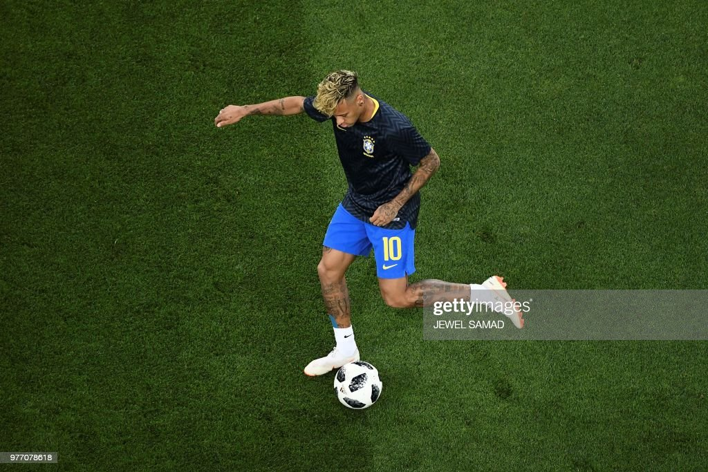 TOPSHOT - Brazil's forward Neymar warms up for the Russia 2018 World Cup Group E football match between Brazil and Switzerland at the Rostov Arena in Rostov-On-Don on June 17, 2018. (Photo by Jewel SAMAD / AFP) / RESTRICTED