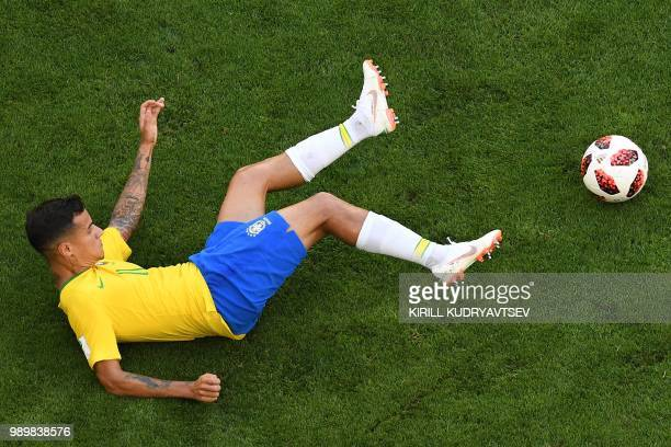 TOPSHOT Brazil's forward Philippe Coutinho falls on the ground during the Russia 2018 World Cup round of 16 football match between Brazil and Mexico...