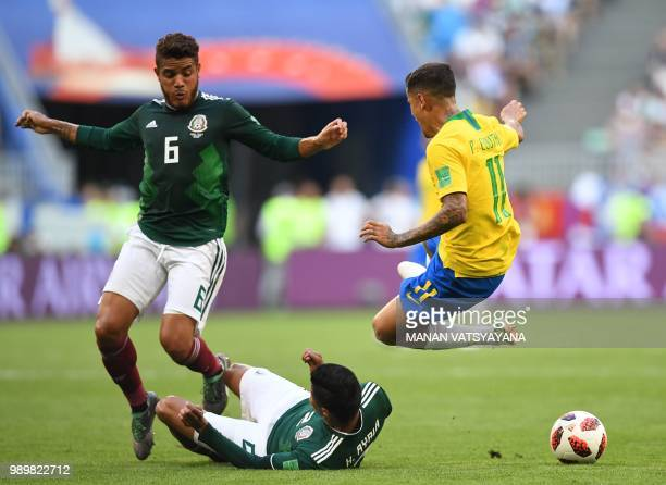 Brazil's forward Philippe Coutinho runs and vies for the ball with Mexico's defender Hugo Ayala and Mexico's midfielder Jonathan dos Santos during...