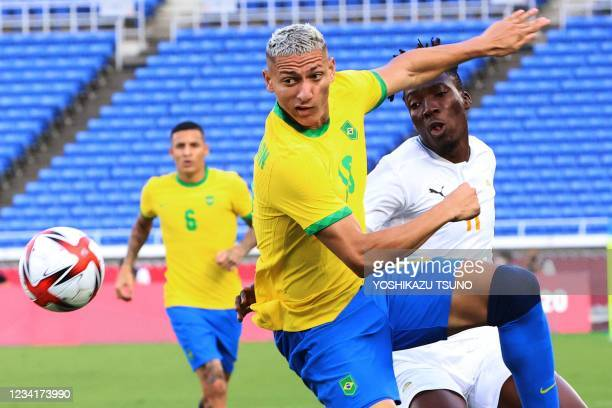 Brazil's forward Richarlison fights for the ball with Ivory Coast's defender Zie Ouattara during the Tokyo 2020 Olympic Games men's group D first...