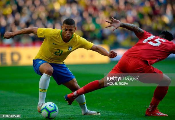 Brazil's forward Richarlison vies with Panama's defender Eric Davis during an international friendly football match between Brazil and Panama at the...