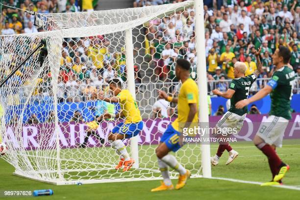 Brazil's forward Roberto Firmino celebrates after scoring a goal during the Russia 2018 World Cup round of 16 football match between Brazil and...