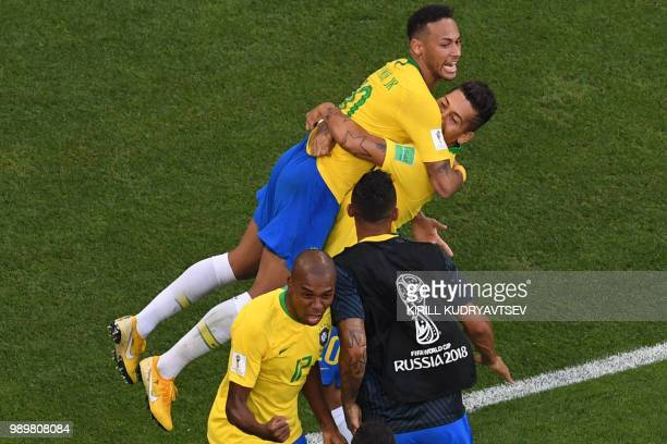 TOPSHOT Brazil's forward Roberto Firmino celebrates with Brazil's forward Neymar scoring his team's second goal during the Russia 2018 World Cup...