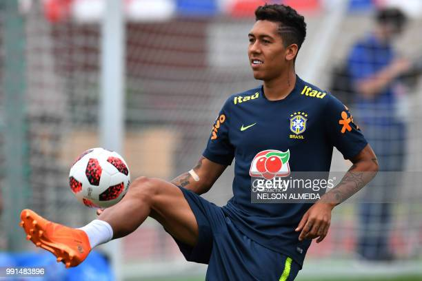Brazil's forward Roberto Firmino controls a ball during a training session at Yug Sport Stadium in Sochi on July 4 during the Russia 2018 World Cup...