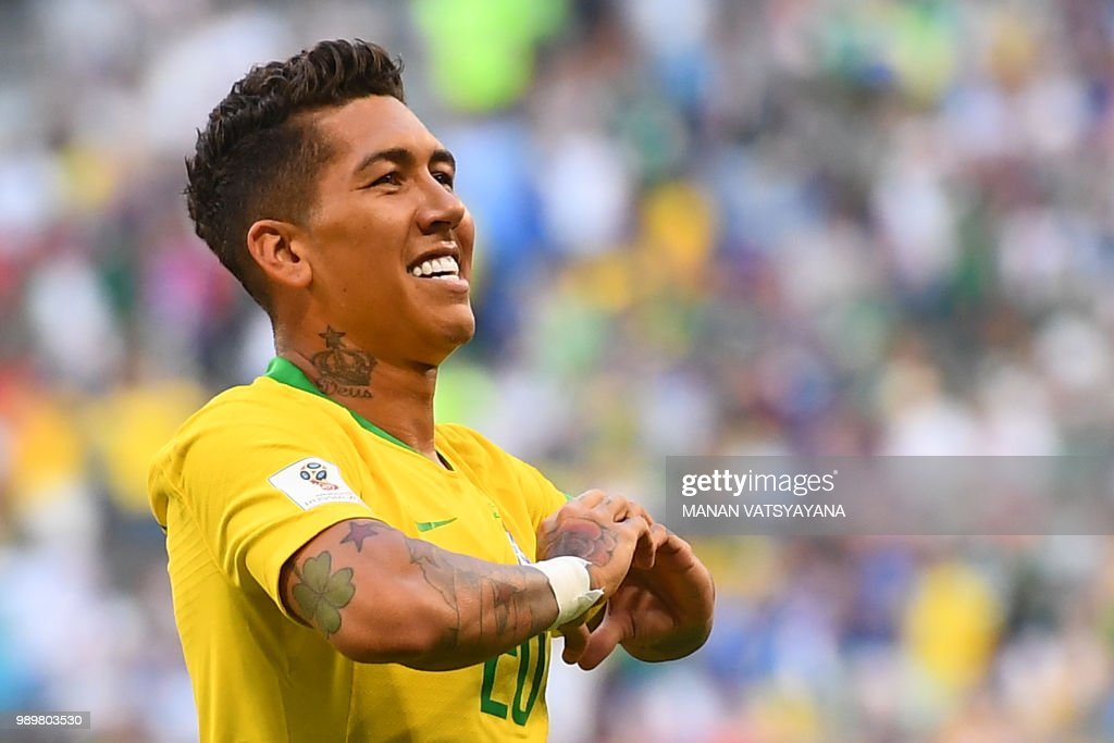 Brazil's forward Roberto Firmino gestures as he celebrates after scoring a goal during the Russia 2018 World Cup round of 16 football match between Brazil and Mexico at the Samara Arena in Samara on July 2, 2018. (Photo by MANAN VATSYAYANA / AFP) / RESTRICTED