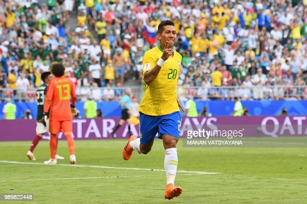 TOPSHOT Brazil's forward Roberto Firmino gestures as he celebrates after scoring a goal during the Russia 2018 World Cup round of 16 football match...