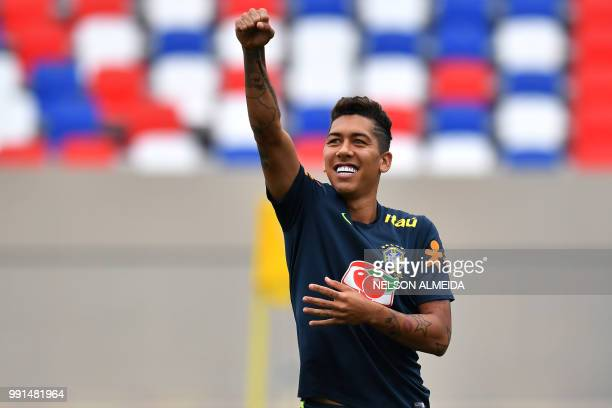 Brazil's forward Roberto Firmino gestures during a training session at Yug Sport Stadium in Sochi on July 4 during the Russia 2018 World Cup football...