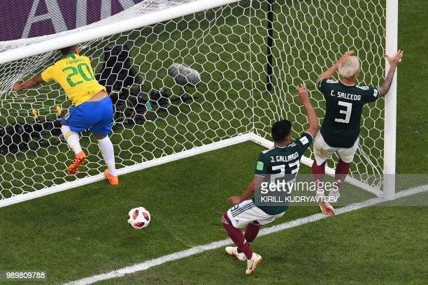 Brazil's forward Roberto Firmino scores a goal during the Russia 2018 World Cup round of 16 football match between Brazil and Mexico at the Samara...