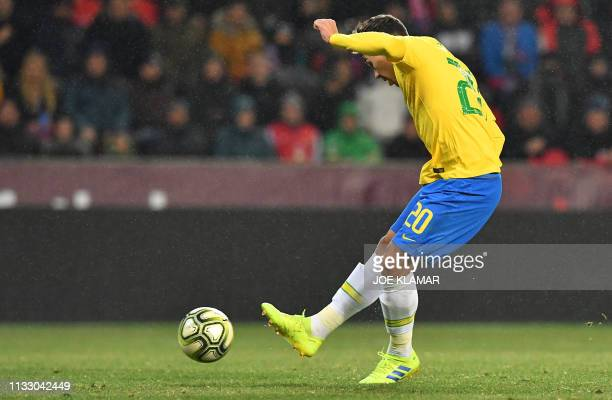 Brazil's forward Roberto Firmino scores to 11 equaliser during the friendly football match between the Czech Republic and Brazil at the Sinobo Arena...