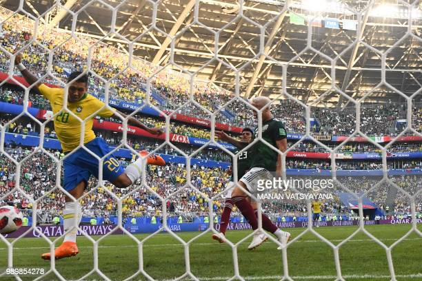 Brazil's forward Roberto Firmino shoots and scores a goal during the Russia 2018 World Cup round of 16 football match between Brazil and Mexico at...