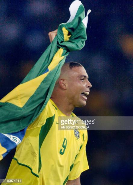 Brazil's forward Ronaldo celebrates after his team defeated Germany 2-0 in the final match of the 2002 FIFA World Cup Korea Japan at International...