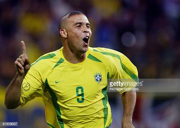 Brazil's forward Ronaldo celebrates after scoring the first goal against Turkey during the semi-final match of the FIFA 2002 World Cup Korea Japan 26...