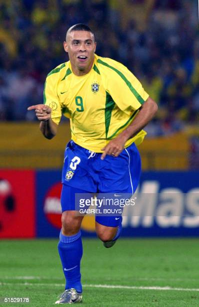 Brazil's forward Ronaldo celebrates after scoring the second goal against Germany during the final match of the FIFA 2002 World Cup Korea Japan at...