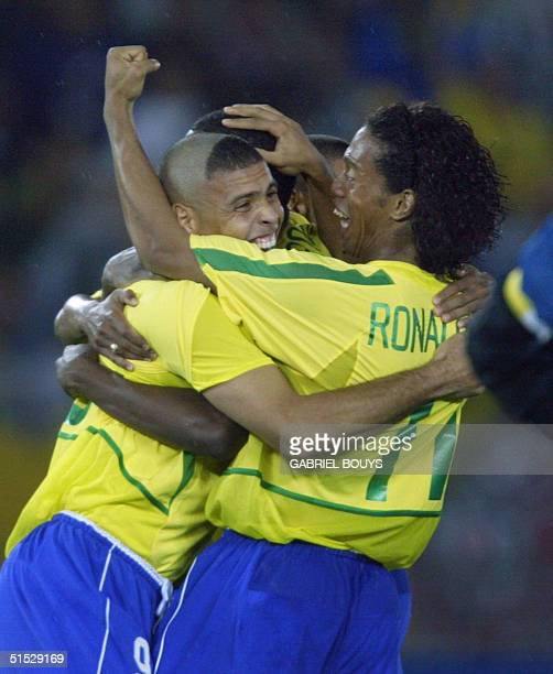 Brazil's forward Ronaldo celebrates with midfielder Ronaldinho after scoring the first goal against Germany during the final match of the FIFA 2002...