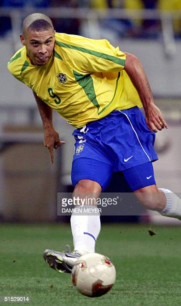 Brazil's forward Ronaldo controls the ball during match 62 of the 2002 FIFA World Cup Korea Japan semifinals 26 June 2002 in Saitama Japan Ronaldo...