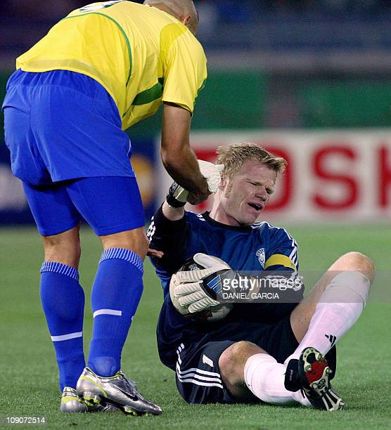 Brazil's forward Ronaldo helps dejected German team captain and goalkeeper Oliver Kahn get up following Germany's 02 loss against Brazil in match 64...