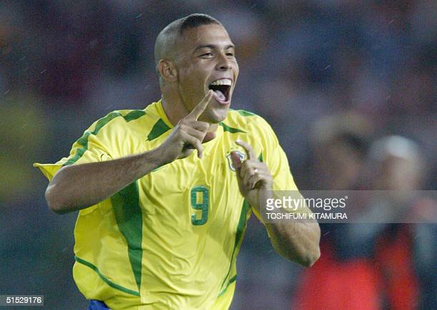Brazil's forward Ronaldo signals number one after scoring the first goal against Germany during match 64 of the 2002 FIFA World Cup Korea Japan final...