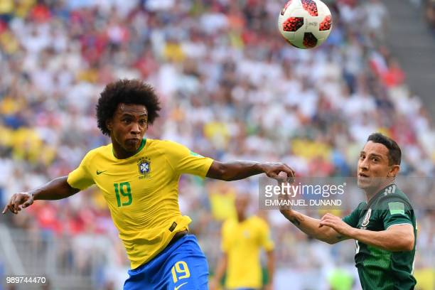 TOPSHOT Brazil's forward Willian and Mexico's midfielder Andres Guardado vie for the ball during the Russia 2018 World Cup round of 16 football match...