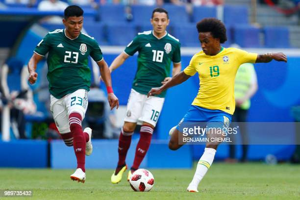 Brazil's forward Willian vies with Mexico's defender Jesus Gallardo during the Russia 2018 World Cup round of 16 football match between Brazil and...