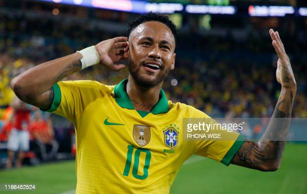 Brazil's foward Neymar Jr. Celebrates after scoring against Colombia during their international friendly football match between Brazil and Colombia...
