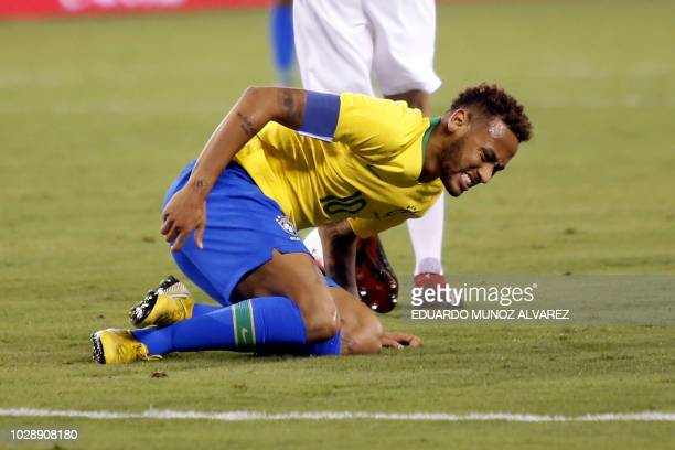 Brazil's foward Neymar lies on the field after a fault during the friendly match against US at the Metlife Stadium in East Rutherford New Jersey on...