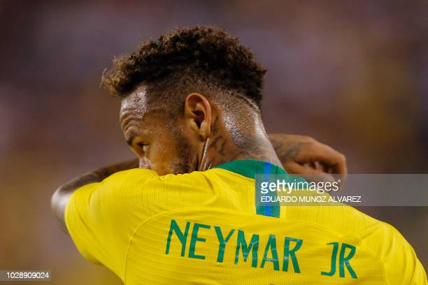 TOPSHOT Brazil's foward Neymar looks on during the international friendly match between Brazil and the US at the Metlife Stadium in East Rutherford...