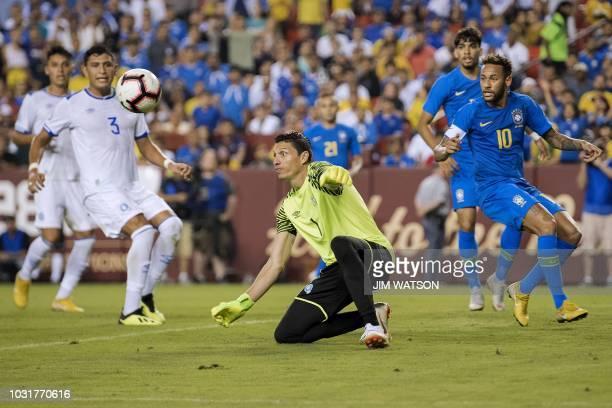 Brazil's foward Neymar looks onthe ball as El Salvador's goalkeeper Henry Hernandez tries to grab it during the international friendly match between...