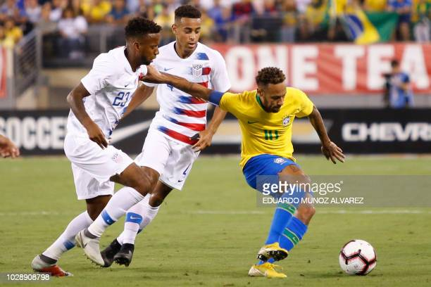 Brazil's foward Neymar vies for the ball against US midfielder Kellyn Acosta during the international friendly match between Brazil and the US at the...