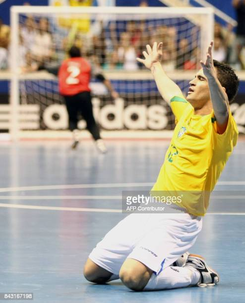 Brazil's futsal player Falcao celebrates the third goal against Italy during a match of the FIFA Futsal World Cup on October 12 2008 at Maracanazinho...