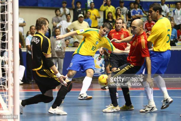 Brazil's futsal player Lenisio vies for the ball with Spain's goalkeeper Luis Amado and Javi Rodriguez on October 19 2008 during their FIFA Futsal...