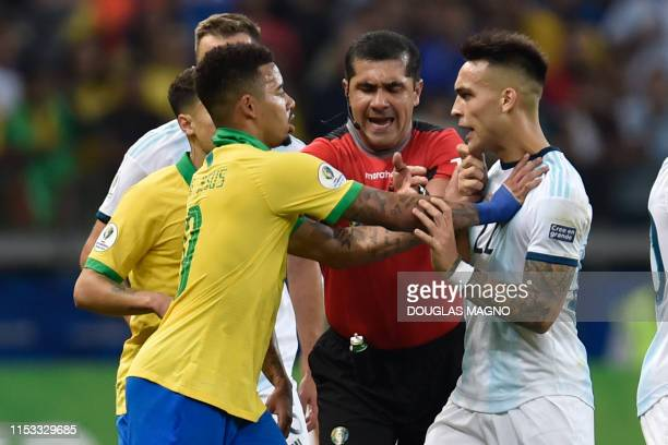Brazil's Gabriel Jesus and Argentina's Lautaro Martinez argue during their Copa America football tournament semifinal match at the Mineirao Stadium...