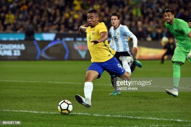 Brazil's Gabriel Jesus attacks Argentina goalpost during their friendly international football match between Brazil and Argentina at the MCG in...