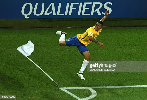 TOPSHOT Brazil's Gabriel Jesus celebrates after scoring against Bolivia during their Russia 2018 World Cup football qualifier match in Natal Brazil...